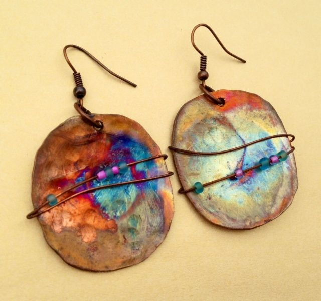 These earrings are hand crafted from copper. They have been hammered, torched for color and wrapped in thin copper wire with beads that compliment the vibrant colors of the copper. Fire Flies Metal Art