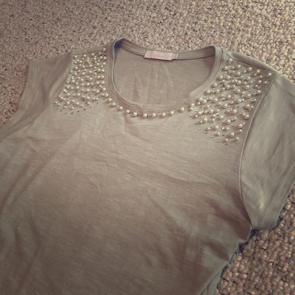 """Pearl & gem bedazzled tshirt. I bought this at a little boutique in Florence, Italy and just haven't had many chances to wear it. All gems and pearls are intact. Khaki color, slightly sheer so a nude tank or bra underneath is recommended. 100% cotton. 18.5"""" armpit to armpit. 28"""" top to bottom. Is an XL but fits a large as well, seems to run slightly small. Great way to class up a pair of jeans, or can be tucked into a pencil skirt for work  Le Camicie Di Ghiara Tops Tees - Short Sleeve"""