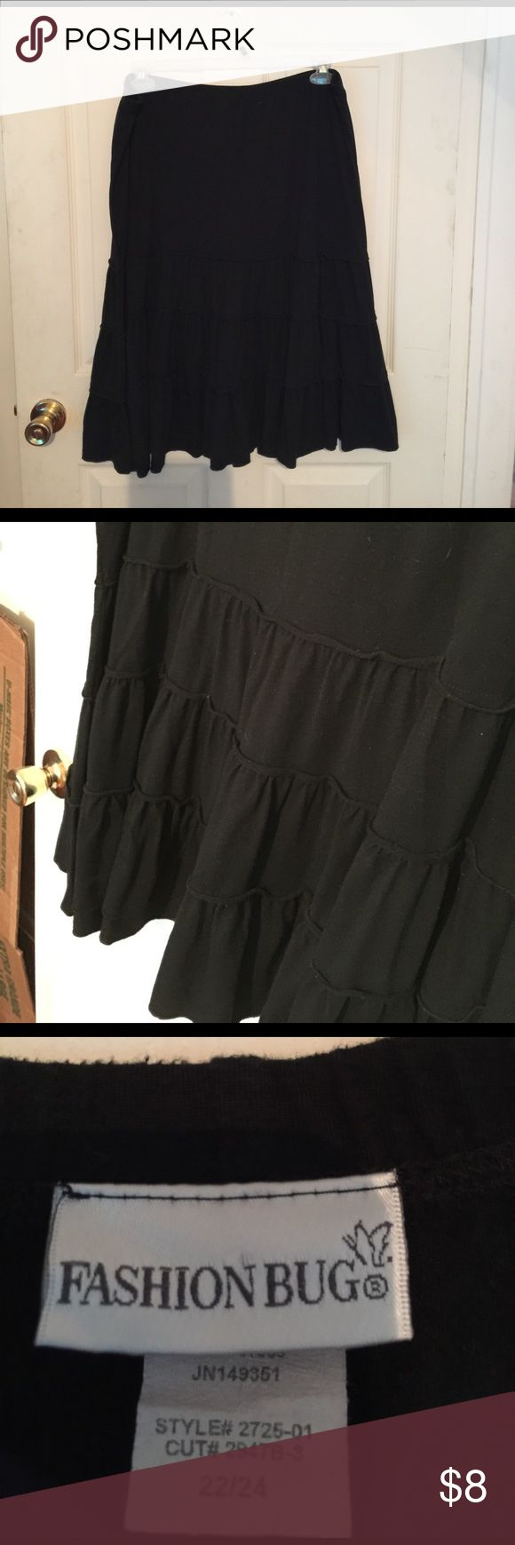"""Black cotton blend pull on skirt. Black pull on cotton blend skirt. Feels like a heavy t-shirt type material, very comfy. It measures 26"""" long and has 3 layered ruffled effect on bottom. Fashion Bug Skirts"""