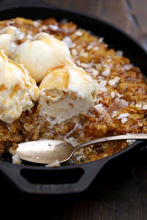 This one dish Coconut Caramel Pumpkin Oatmeal Skillet Cookie takes just 10 minutes to prepare and is the definition of a perfect fall dessert. Coconut flakes and rolled oats are stirred into a pumpkin oatmeal cookie base and baked in the same pan that it was mixed in. It's then topped with additional coconut, oats, caramel sauce and ice cream to create the seasonal dessert of your dreams.