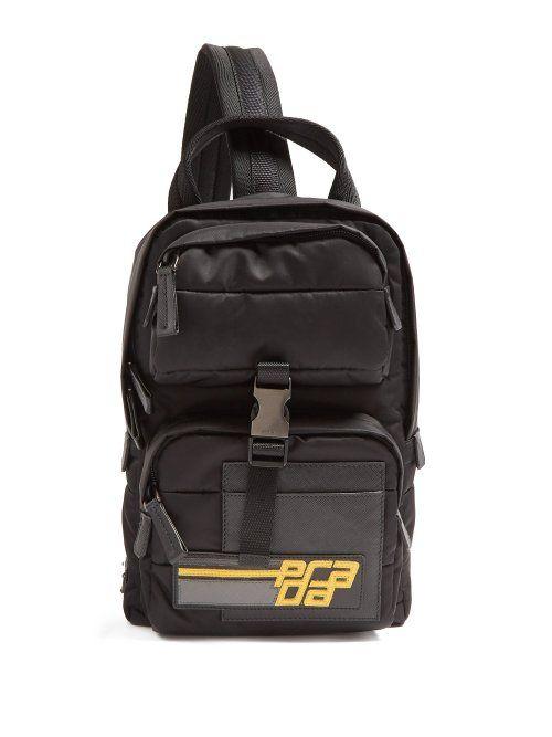 7008cecb8a75 PRADA PRADA - LOGO PATCH NYLON BACKPACK - MENS - BLACK. #prada #bags  #leather #nylon #backpacks