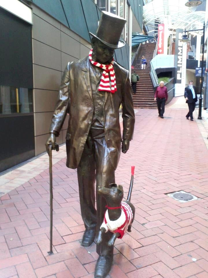 John Plimmer and his dog Fritz wrapped up against the wind (Plimmer Steps, Lambton Quay)