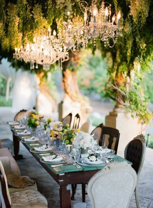 I'd love outdoor chandeliers and large candelabras on the tables.