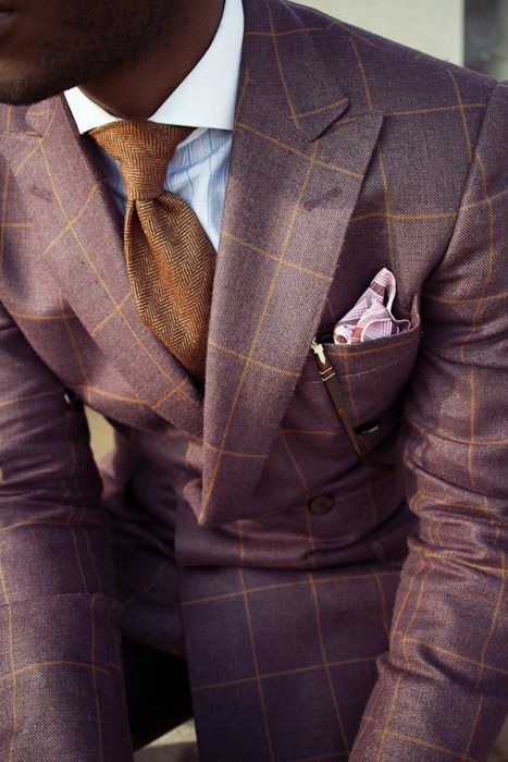 this man is not afraid of color.  isn't the pocket square on this one cute?
