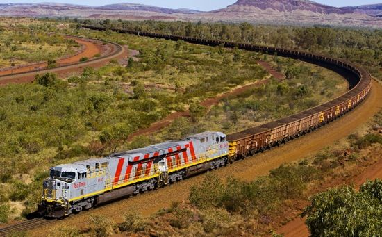 A train carrying iron ore from a Rio Tinto mine in the Pilbara region of Western Australia is seen in this undated handout photograph obtained May 4, 2010.