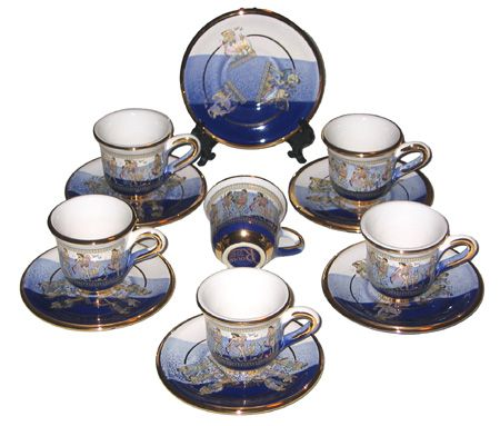 Set of six cups and saucers trimmed with 24 Karat gold. Hand made in Greece