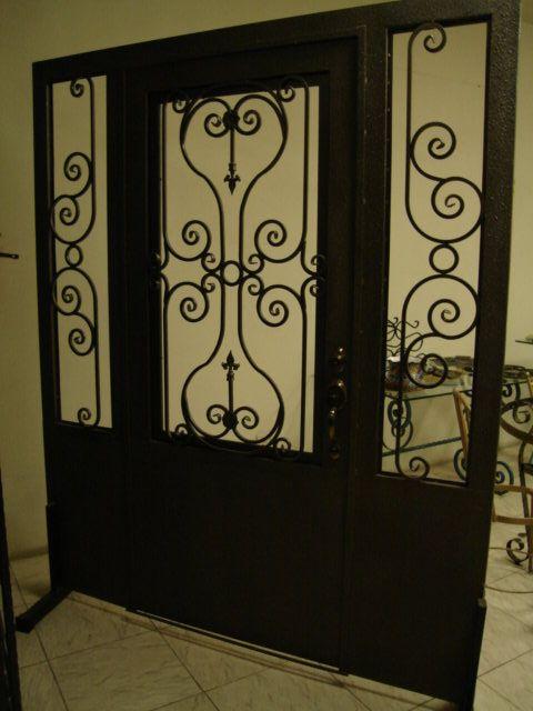 Resultado de imagen para rejas en madera para puertas principales