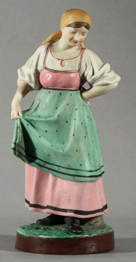 ANTIQUE RUSSIAN GARDNER PORCELAIN FIGURE OF A DANCING PEASANT WOMAN, GARDNER PORCELAIN FACTORY, MOSCOW, LATE 19TH CENTURY. SHE IS WEARING A  PINK DRESS AND A PEA.GREEN APRON