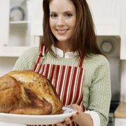 Roasting a turkey for the holidays or for a special occasion takes a lot of preparation to ensure that the bird cooks properly. Roasting the turkey upside-down or with the breast-side down, allows the breast meat to stay moist while the legs and thighs cook to the appropriate temperature. When the turkey is placed upside down, the juices from the...