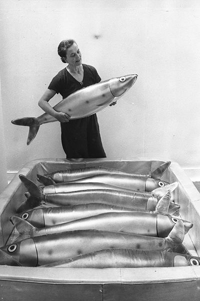 Francois-Xavier Lalanne - Big Fish, June 3, 1976 / Claude Lalanne places another giant sardine into the tin as she and her husband Francois-Xavier Lalanne prepare their sculpture exhibits for an exhibition at the Whitechapel Art Gallery, London.