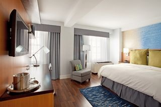 Plush beds and contemporary furnitures at Hotel Indigo Baton Rouge