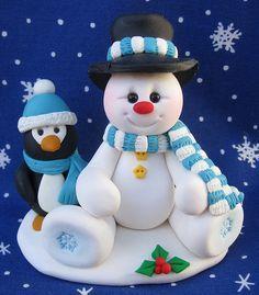 Muñeco de nieve y pingüino navideño en fimo