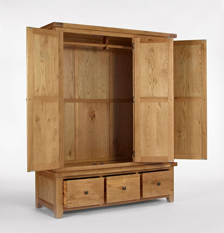 Devon Oak Triple Wardrobe with Drawers- http://solidwoodfurniture.co/product-details-oak-furnitures-5152-devon-oak-triple-wardrobe-with-drawers.html