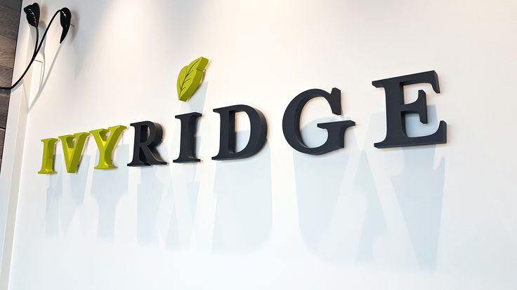 """Ivy Ridge wall sign 1-½"""" thick acrylic painted to match custom PMS colours attached to the wall with threaded rods Customer Solutionworx  #signage #office sign #sign company #sign design #wall design"""
