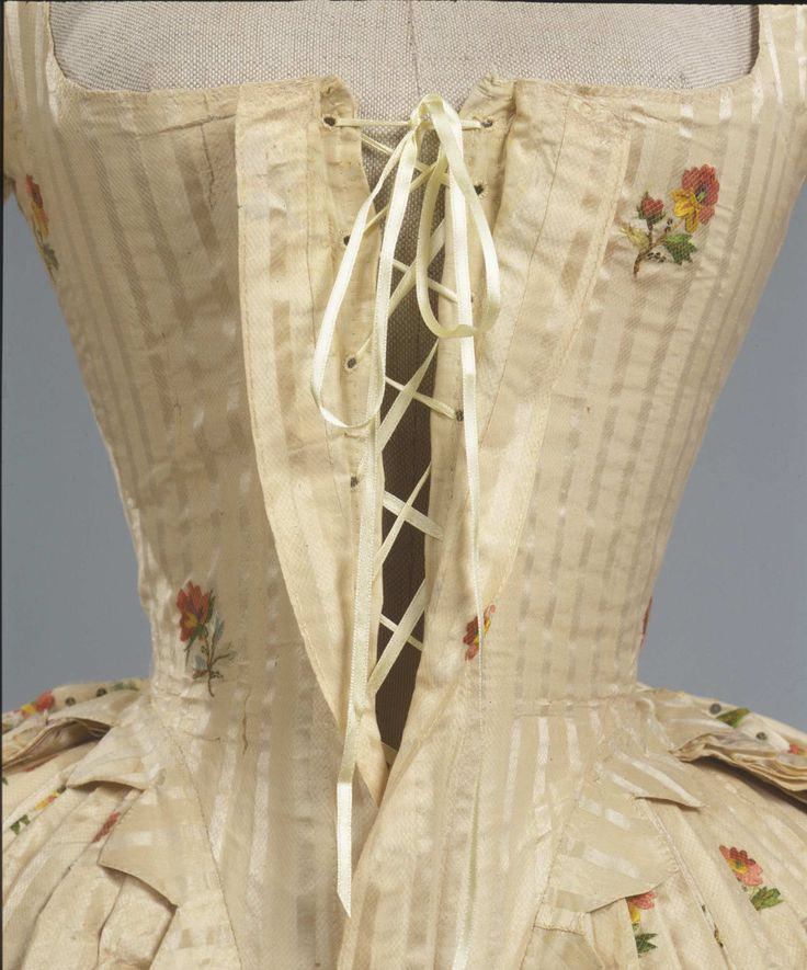 Detail front closure, robe à l'anglaise, Italy, ca. 1780. Ivory striped silk pékin, embroidered with floral sprays and floral branches in polychrome silk thread.