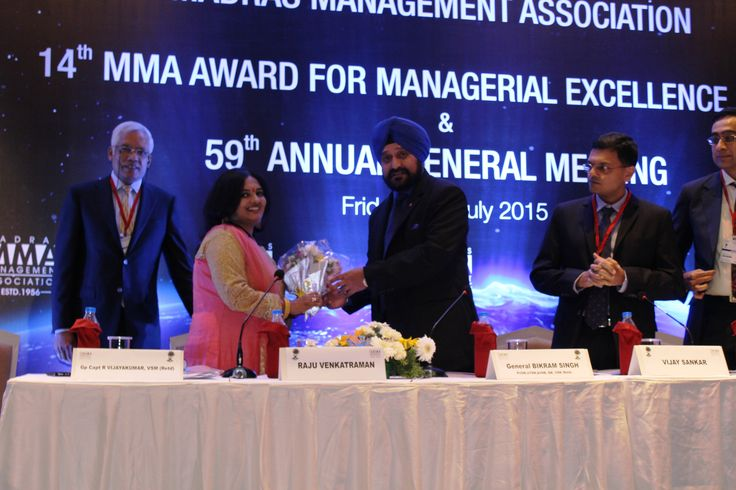 Padmaja victory insights receiving bouquet from General Bikram Singh at the 59TH MMA AGM MAME AWARDS EVENT