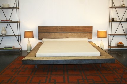 Platform bed, made from steel and wood reclaimed from 1880 whiskey distillery.//Want.