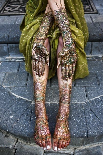 beautiful hand and leg Henna with green. This color pallet is just really cool