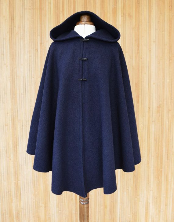 $144.50 Womens hooded cape made from boiled wool fabric in a rich navy blue color . Fastened with three toggle buttons, this cape Designed and handmade in Scotland.More versatile - can wear the rain or blue jean jacket under if needed