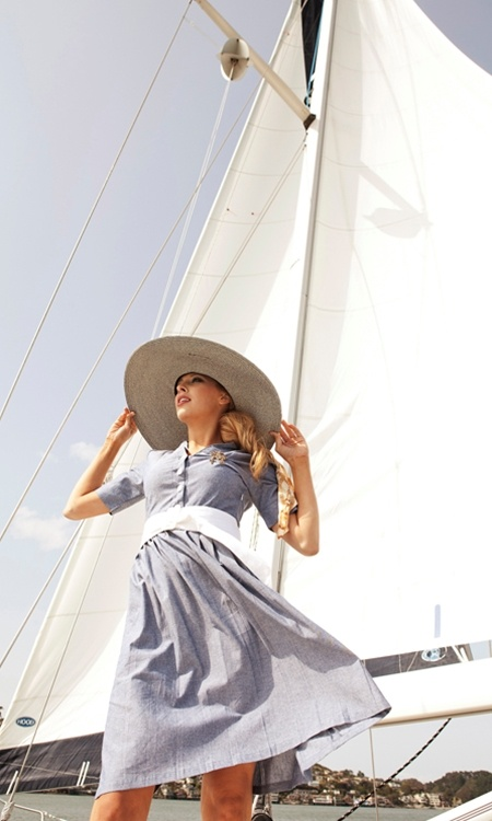 Out boating. Chambray dress with sun hat.