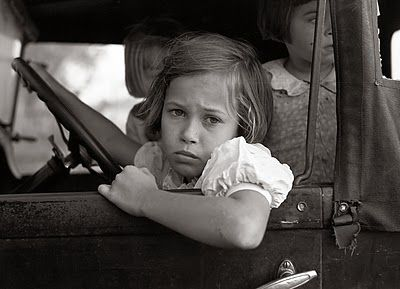 Eyes of the Great Depression: Children waiting on parents in car, taken in 1938 in Jarreau, Louisiana.