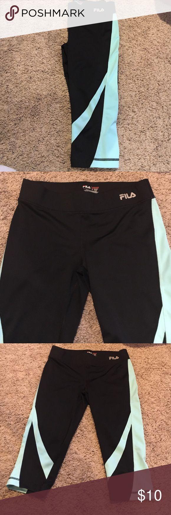 Fila capri legging Fila active capri leggings. Navy and aqua. Great condition! Fila Pants Leggings