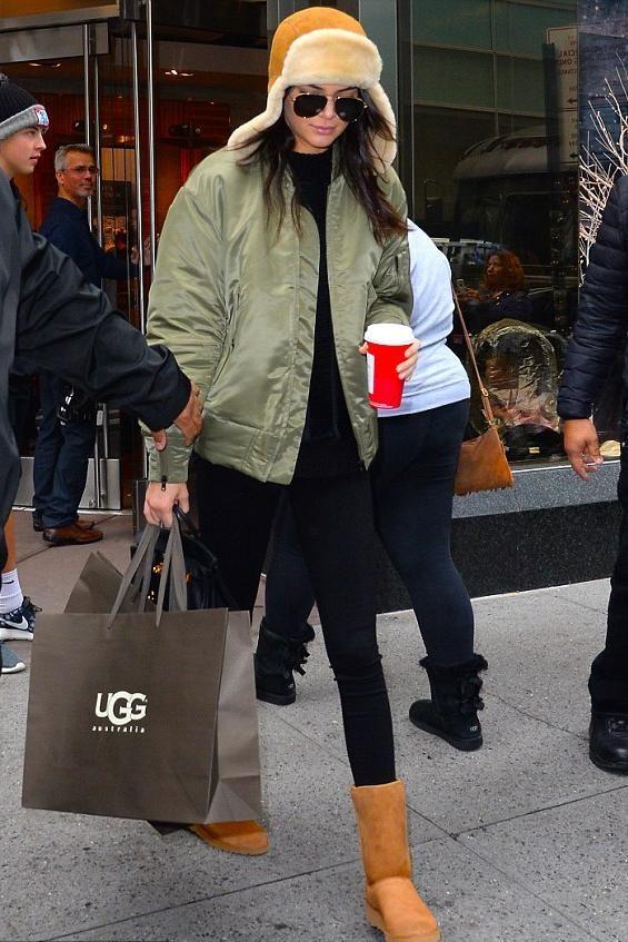 Kendall Jenner wearing Saint Laurent Classic 11 Aviator Sunglasses, Hermes Birkin 25cm Bag, Ugg Australia Amie Wedge Boots in Chestnut, Adidas Originals by Kanye West Yeezy Bomber Jacket in Elm and Ugg Australia Sheepskin Trapper Hat in Chestnut