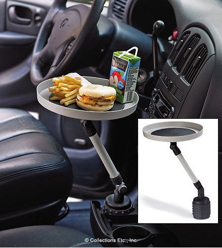 Forget the cup holder this thing holds your dinner while you are stuck in rush hour traffic! - for a kid, this is genius! lol