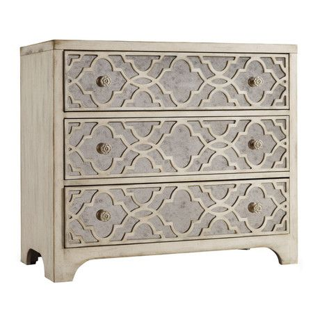 Abounding with elegant appeal, this 3-drawer chest showcases quatrefoil overlay and mirrored panels for glamorous style.   Product: ...