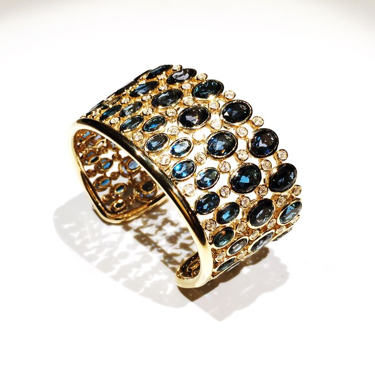 Cuff. London Blue Topaz. Diamonds. Mounted in yellow Gold. Custom design by Kathaline Page.Guth