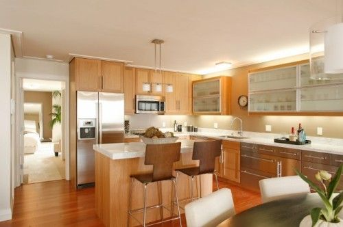natural wood cabinets with white countertops 2