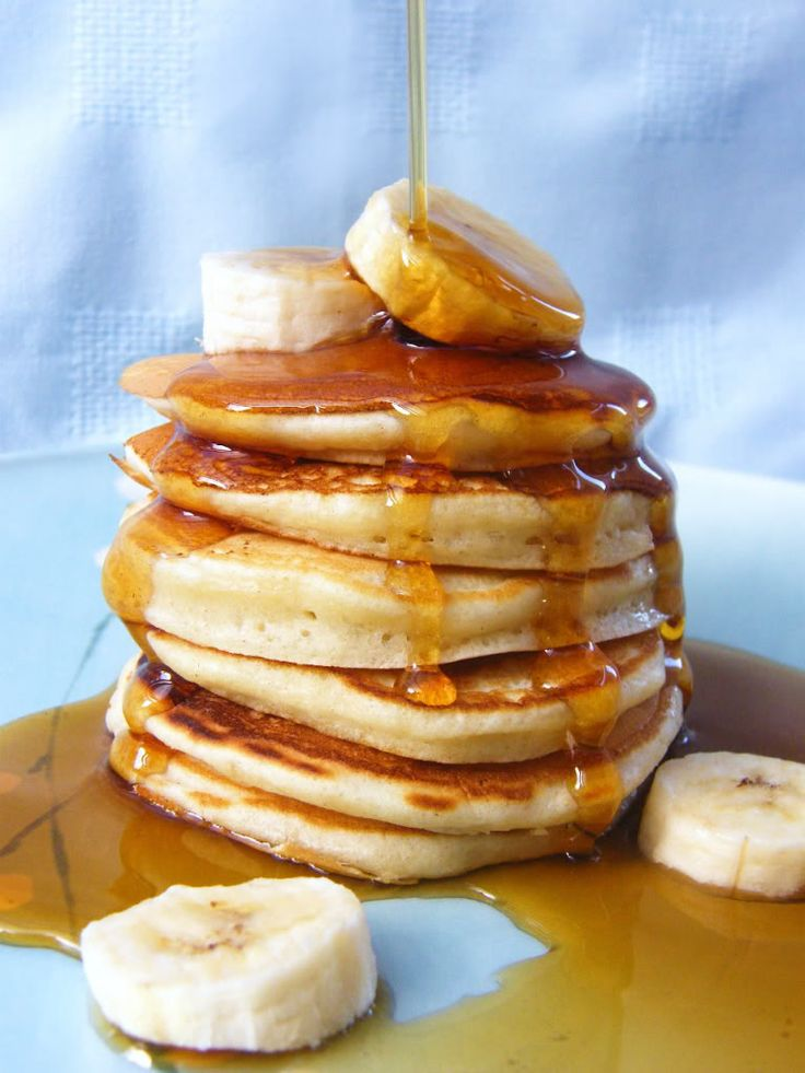 Scottish or Scotch Pancakes (sometimes known as drop cakes) with maple syrup & bananas.