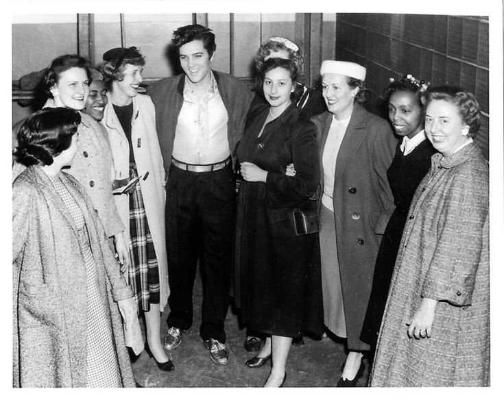 "1957: This rather buttoned-down group of fans hardly seems reflective of the typical screaming, hyperventilating Elvis Presley teen female follower in the 1950s, but Presley, that charming former truck driver from Tupelo, Miss., drove headlong into the hearts of all stripes of fans. In fact, this photo brings to mind a Presley song from the time: ""(You're So Square) Baby I Don't Care."" These women, who seem pleased, but not exactly all shook up, are from the Detroit Police Department and…"