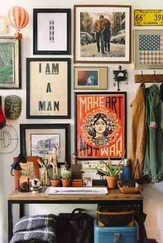 Stacked, eclectic wall art helps create a bohemian vibe   The Everygirl NYC Fizz 56 Apartment Shoot by Michelle Lange Photographer