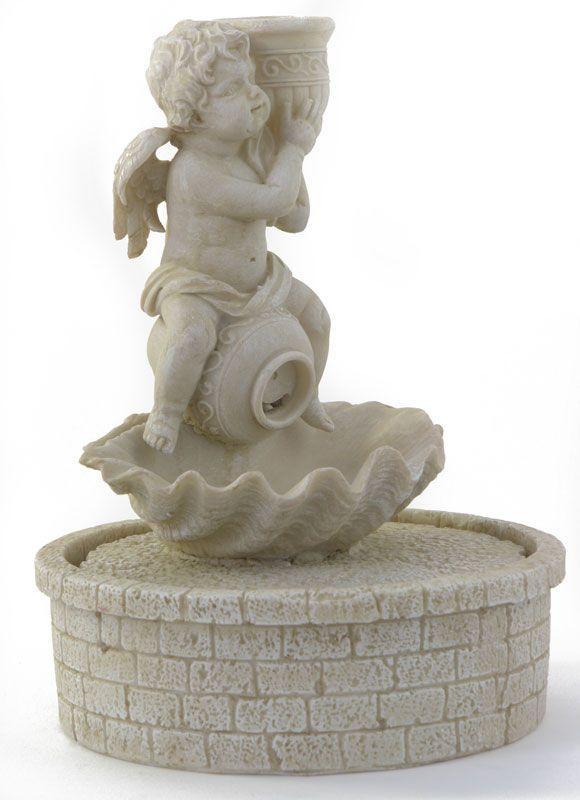 urocza fontanna domowa ze świecznikiem