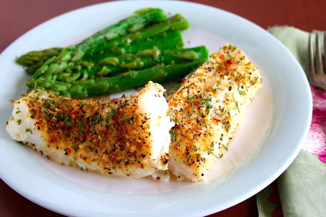 Lemon Pepper Cod 1c fresh or dried bread crumbs 1/4c parsley, chopped 1tsp lemon pepper, ground 1/2tsp salt 24oz firm white fish fillets, fresh or frozen, thawed 2Tbsp butter, melted 2 lemons, juiced Preheat oven 450F. In bowl, combine bread crumbs, parsley, pepper & salt. Set aside. Dip fish in melted butter & coat both sides w/crumb mixture. Place on baking sheet, bake til cooked through yet flaky to the fork, about 10 minutes. Sprinkle with lemon juice and serve. easy as that!