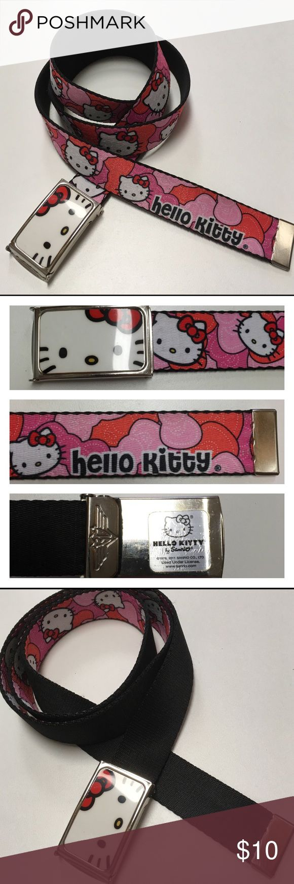 """Hello Kitty Web Belt Reversible & Adjustable Great belt. Bright colors. Good condition. Has a few scratches on the metal end. See picture. Can be worn on Print side or black side. 1.25"""" wide. 46"""" inches long. Could be shorter. Depends how much you would like hanging. Hello Kitty Accessories Belts"""