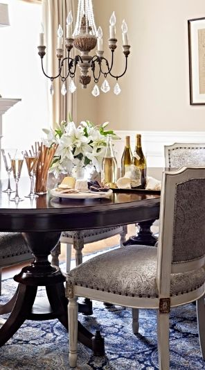 Stunningly handsome with its high gloss mahogany finish, the Ashdale Pedestal Dining Table shows its feminine side too, from the curvature of the oval top to the dramatic lines of the four-legged double pedestal below.    Frontgate Interiors