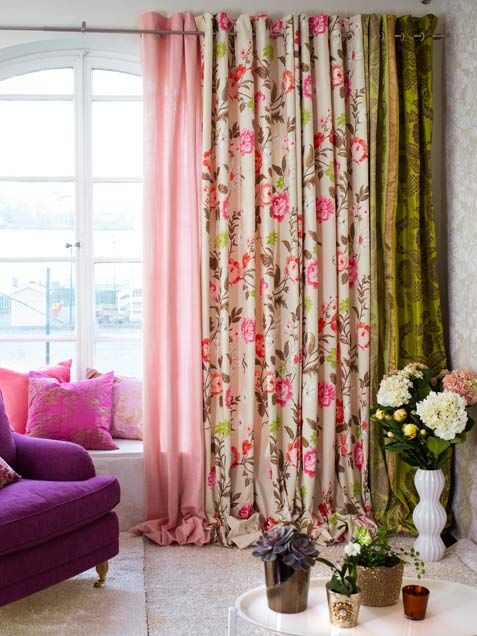 Multiple curtains with mixed prints and colors -- this could work with bohemian, eclectic, romantic or many other home decor styles!