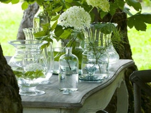 Simple collection of glass vessels with greens.