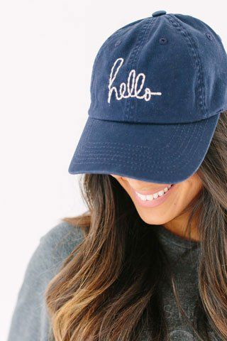 Washed canvas baseball cap with adjustable strap. Embroidered hello script. beaucoup collection