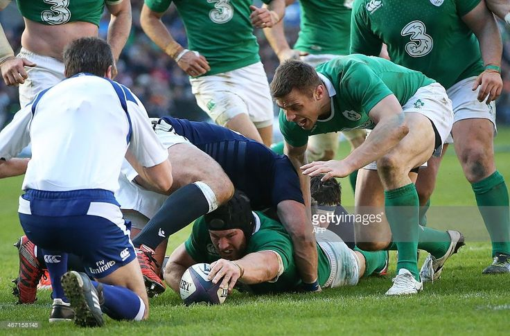 Ireland's flanker Sean O'Brien scores his second try during the Six Nations international rugby...