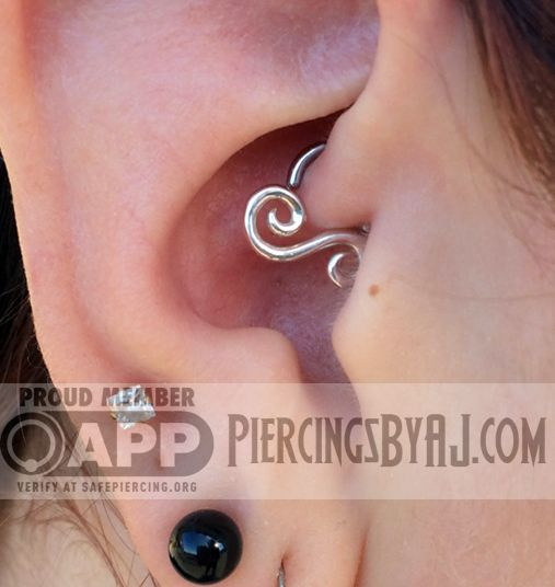 "Fully healed 16g daith piercing with ""Archimedes"" heart design from Leroi.  Love this original piece!"