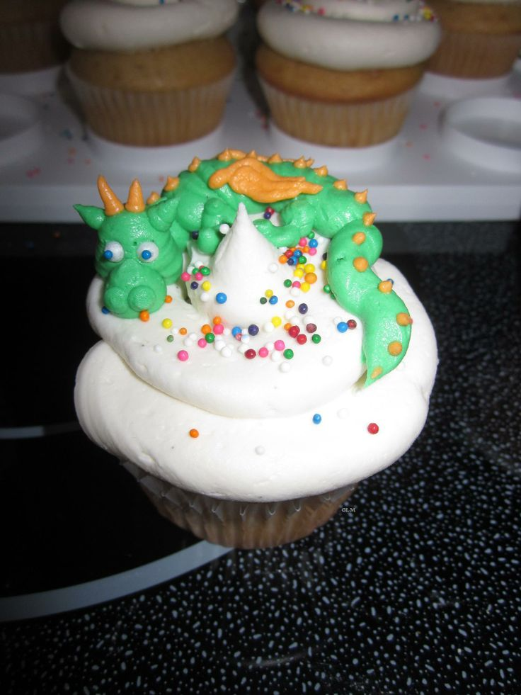 Dragon cupcakes. Made with buttercream, piped directly onto the cupcake. Takes a bit of patience, but overall not too difficult!
