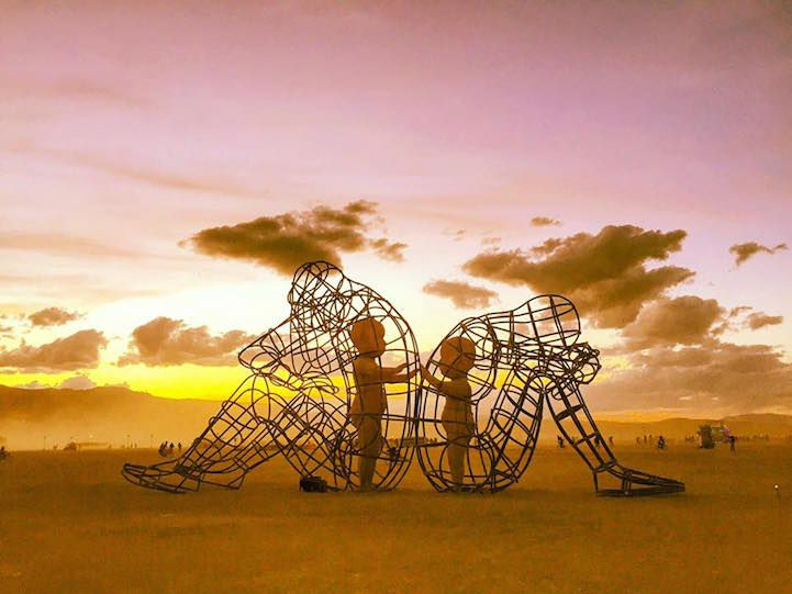 Burning Man Sculpture Reveals Inner Child Glowing within Giant Wire-Framed Adult Bodies - My Modern Met
