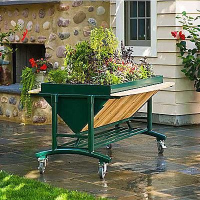 A serious gardening solution for the serious gardener! This innovative garden table is ergonomically designed at waist-high so you can garden in comfort, without bending or kneeling. Easily fits on patios and perfect for condos and apartments.Gardens Inspiration, Ventures Products, Mobiles Gardens, Rolls Gardens, Products Lgarden, Gardens Planters, Gardens System, Gardens Tables, Elevator Gardens