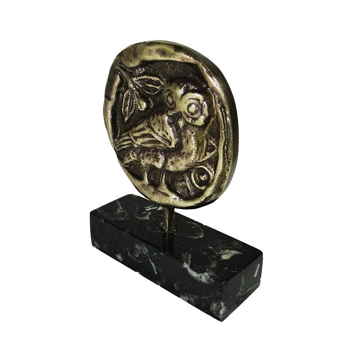 The owl, also known as glaux in Ancient Greece was the symbol of wisdom and knowledge and the sacred bird of Goddess Athena. The sacred bird was also depicted on the reverse side of the tetradrachm coin of Athens. 449-419 B.C., Athens Dimensions: 7 cm x 9 cm x 3,5 cm Dimensions of the marble base: 7 cm x 2 cm x 3,5 cm Bronze, placed on marble base.