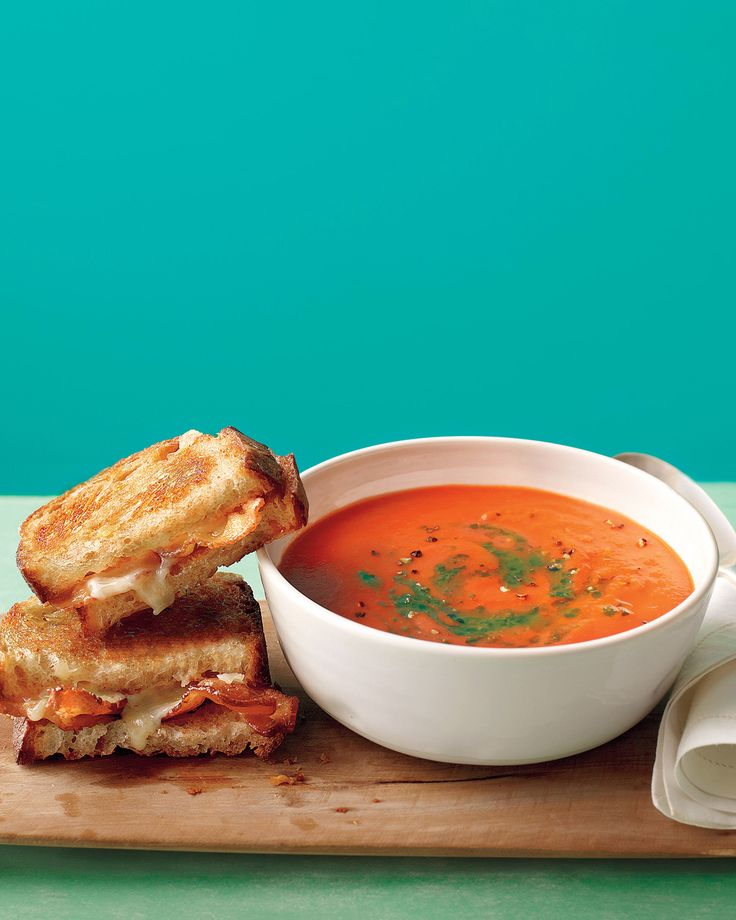 Tomato Soup with Bacon Grilled Cheese | Martha Stewart Living - This classic combo stirs pesto (or salsa verde) into the tomato soup and adds bacon to the grilled cheese sandwich for an ideal lunch or dinner for one.