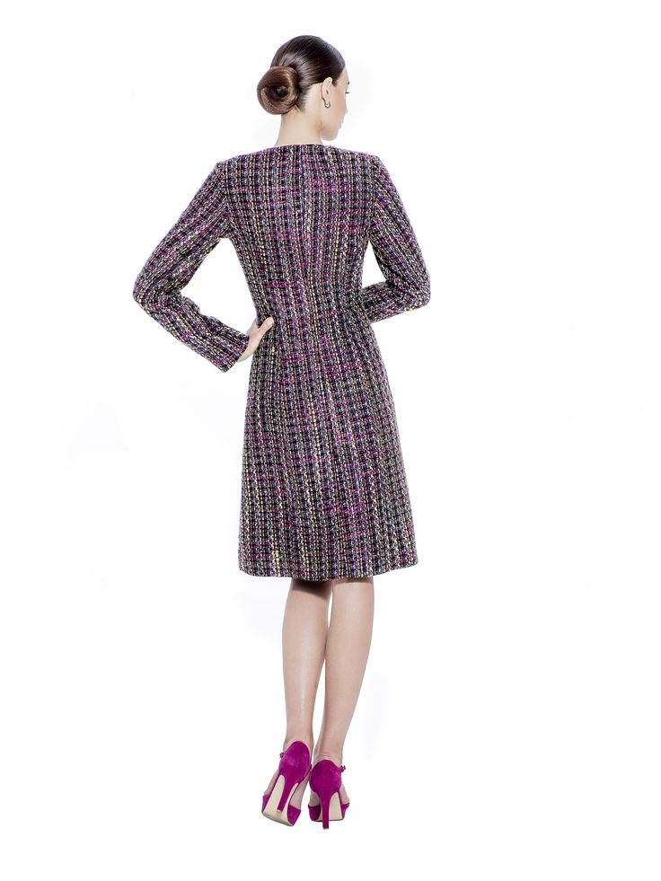 The unique 'A' shape coat with crossing zip and slim long sleeves is a must have piece. With its richly textured handwoven boucle tweed finish, this coat deserves to be part of a timeless core wardrobe. This coat makes the perfect companion to the matching boucle tweed skirt. Handvowev boucle fabric imported from France with 100% Viscose lining from Germany.  Washcare: Dry clean  MADE IN EUROPE