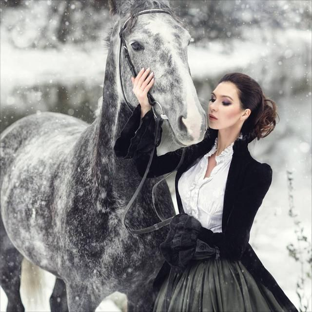 Victorian Noblewoman with her horse in the snow - For costume tutorials, clothing guide, fashion inspiration photo gallery, calendar of Steampunk events, & more, visit SteampunkFashionGuide.com